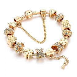 Trendy gold bracelet with charms - hearts - beads - clover - key