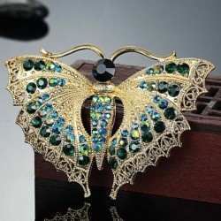Vintage brooch with crystal butterfly