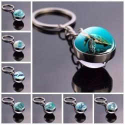 Blue sea life - round double sided glass keychain - turtle / dolphin / seashells